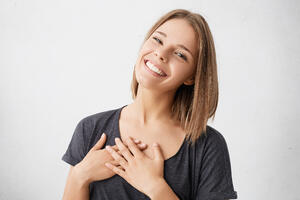 beautiful-positive-friendly-looking-young-mixed-race-woman-with-lovely-sincere-smile-feeling-thankful-grateful-showing-her-heart-filled-with-love-gratitude-holding-hands-her-breast