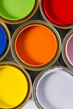 Paint cans on different colors - isolated over white