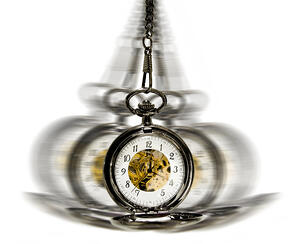 clock in motion over white - time moving
