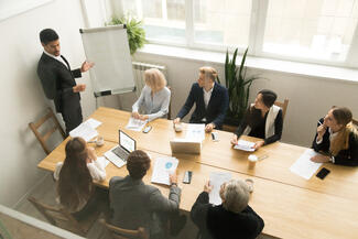 african-american-ceo-giving-presentation-corporate-team-meeting-concept