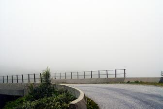 beautiful-scenery-road-gloomy-day-with-foggy-background-norway
