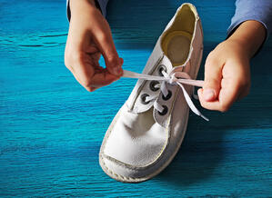 boy-is-learning-how-tie-shoelaces-close-up-hands-shoe