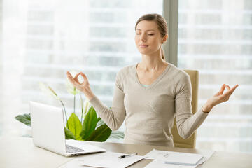 calm-businesswoman-relaxing-with-breath-gymnastics
