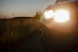 car-riding-road-with-headlights