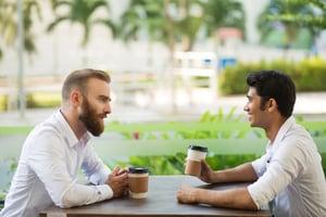 confident-businessman-explaining-his-plan-partner