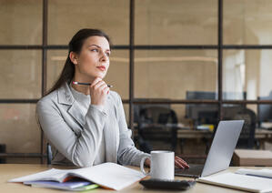 contemplating-businesswoman-sitting-front-laptop-office-1
