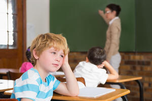 cute-pupil-paying-attention-classroom