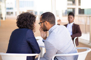 employees-gossiping-about-young-female-colleague-1