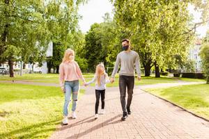 family-members-walking-park-wearing-fabric-face-masks