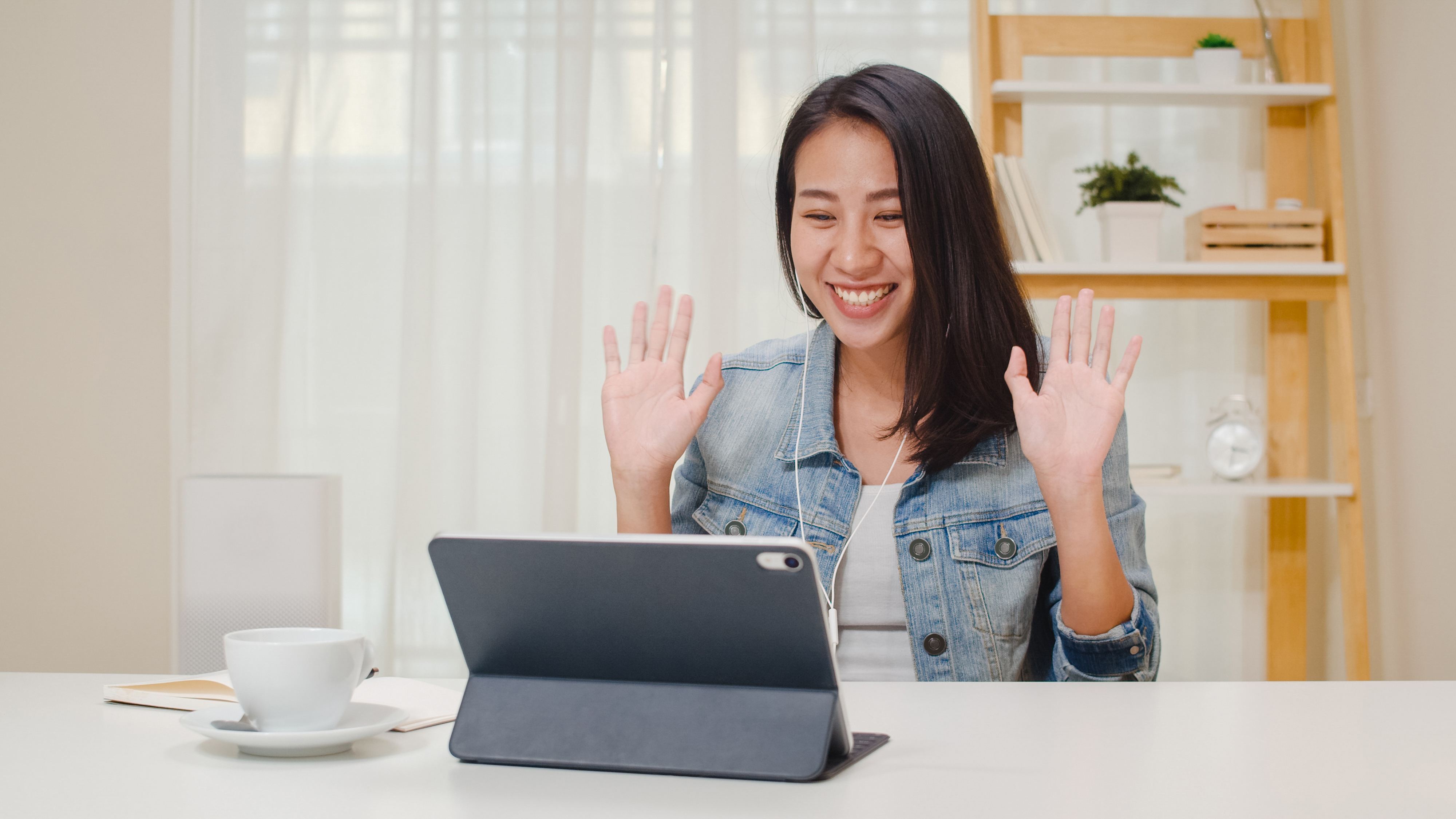 freelance-business-women-casual-wear-using-tablet-working-call-video-conference-with-customer-in-workplace-in-living-room-at-home-happy-young-asian-girl-relax-sitting-on-desk-do-job-in-internet