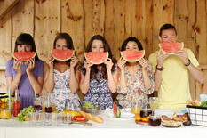 friends-posing-with-watermelon-slices
