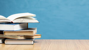 front-view-pile-books-with-copy-space (1)