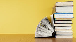 front-view-pile-books-with-copy-space