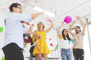 group-enjoy-young-people-celebrating-throwing-confetti-while-cheering-jumping-party-white-room-1