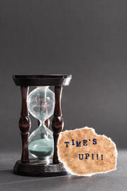 hour-glass-with-time-s-up-text-black-surface