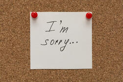i-am-sorry-inscription-text-written-white-paper-pined-cork-board