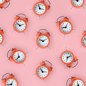 many-coral-red-alarm-clock