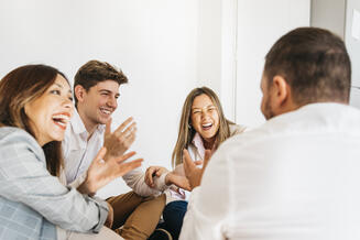 multiracial-group-coworkers-laughing-together