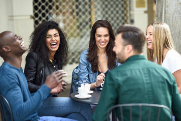 multiracial-group-five-friends-having-coffee-together