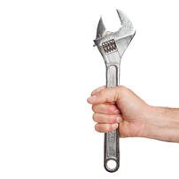 someone-s-hand-holding-spanner