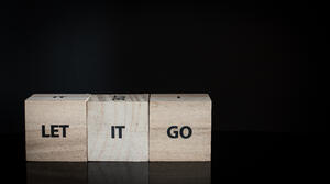 three-wooden-cubes-row-let-it-go