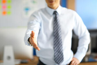 white-collar-worker-showing-his-respect-by-offering-handshake