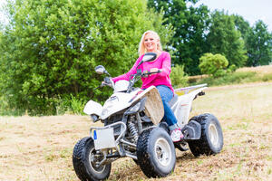 woman-driving-off-road-with-quad-bike-atv