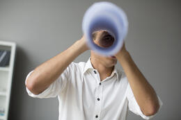 young-man-looking-through-spyglass