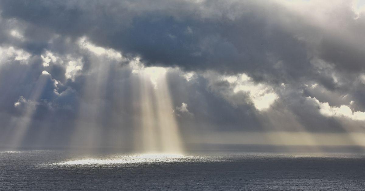 light shining through dark clouds