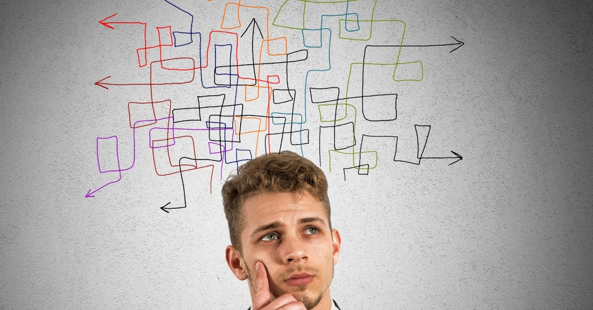 Man thinking and not making decisions with colorful arrows pointing every which way above his head