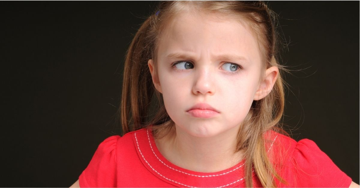 little girl upset looking off into distance