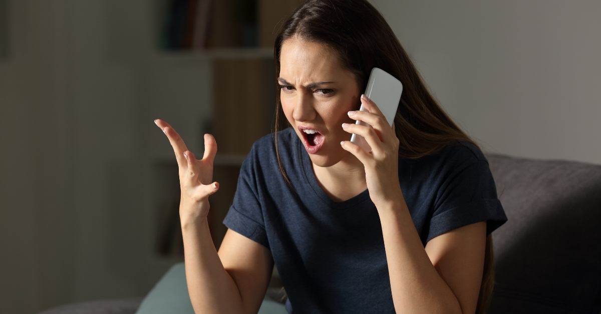 Woman yelling angrily into cell phone